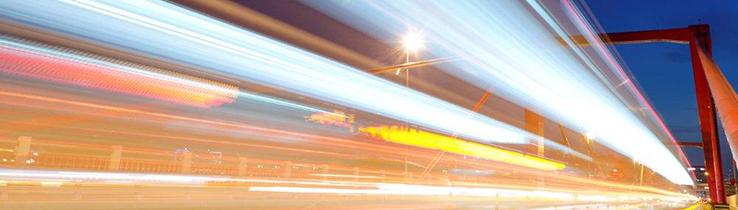 Light blur from vehicles crossing a bridge
