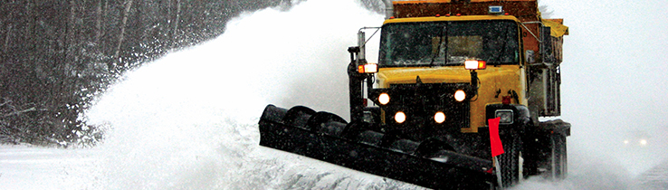 Yelllow Snow Plow clearing a road
