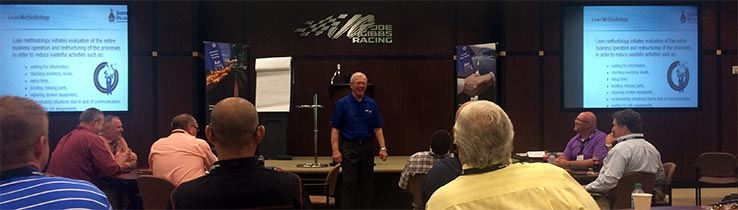 Mr. Joe Gibbs visits with attendees during 2015 EcoLean™ workshop.
