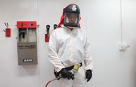 Man White Suit Spray Gun Promo